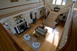 Inside the mansion on the second floor, looking down at the first floor.